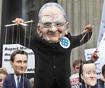 Murdoch journalists stunned-british-demonsrator.jpg