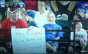 Rangers Fans!-photo_young_rangers_fan_places_bounty_on_brothers_head.jpg