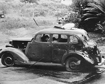 American Civilians killed on December 7, 1941-pearlharbor-car-hit-aa-shells.jpg