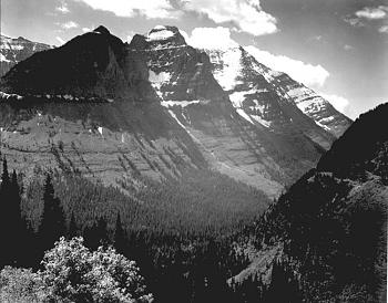 Glacier National Park-glacier_national_park_valley-_snow_covered_mountains_.jpg