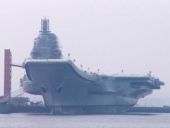 China launches first aircraft carrier on maiden sea trial-varyag_being_fitted_a.jpg