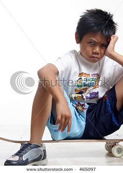 3M to expand broadband Internet in rural U.S.-stock-photo-pouting-boy-sitting-his-skateboard.jpg