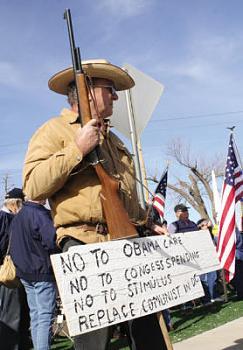 Teacher calls local Tea Party president a Nazi-rifle.jpg
