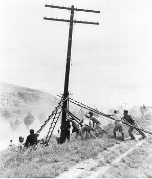The Forgotten War-1950s-korean_workers_aid_telphone_pole_construction.jpg