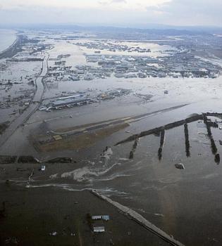 tsunami/quakes-swamped-sendai-airport-northeastern-jap.jpg
