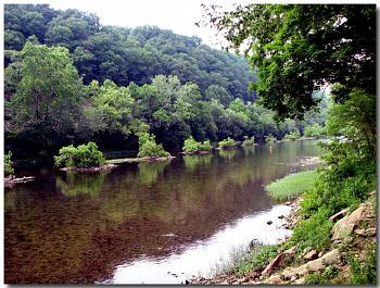 Please give me one good reason to visit West Virginia-great-greenbrier-river-young-lady-fishing-riffles-below-whitcomb-railroad-bri.jpg